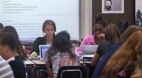 children sitting at desks
